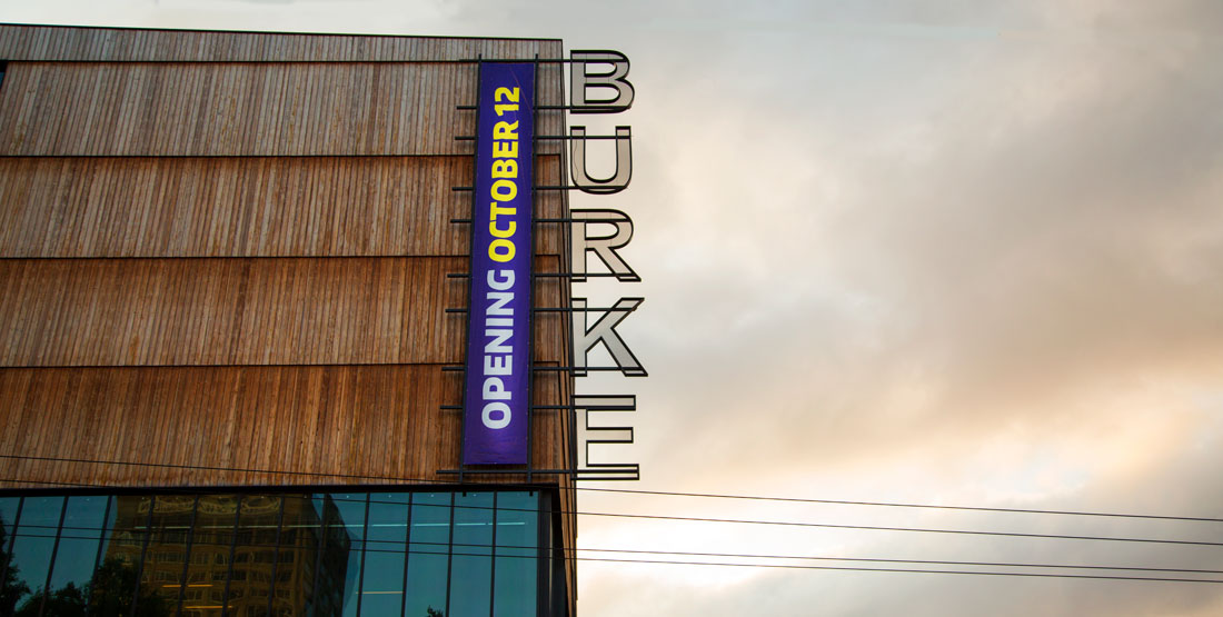 "burke banner reading ""opening October 12"" on the side of the new building"
