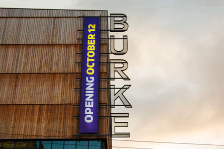 "burke museum exterior sign ""BURKE"" with banner reading ""opening october 12"""
