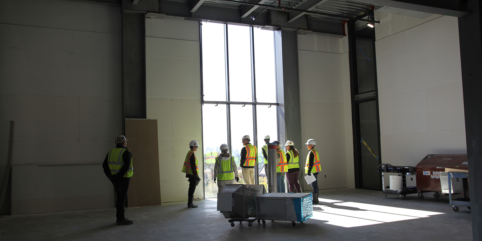 A group with the Burke Museum tours the new building.