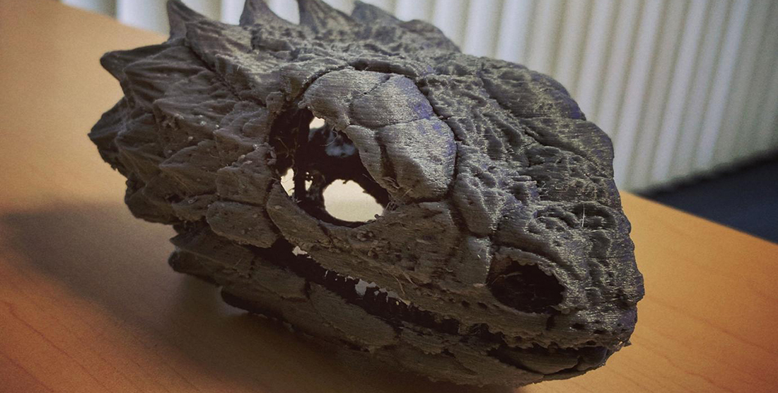 A 3-D printed skull of a giant lizard sitting on a table
