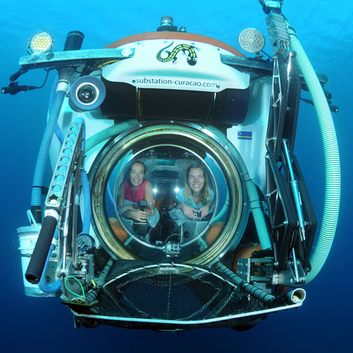 two women inside a submersible porthole window