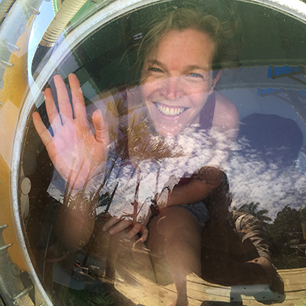 a woman waves from the window of the submersible while it's still above water