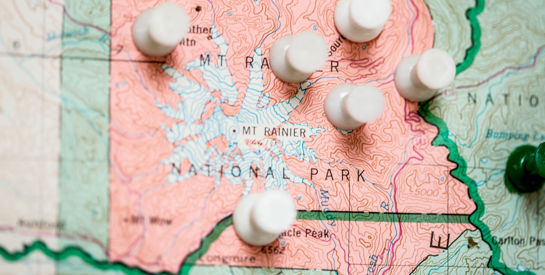 close up of push pins in a map of Washington state -- showing only Mt. Rainier region