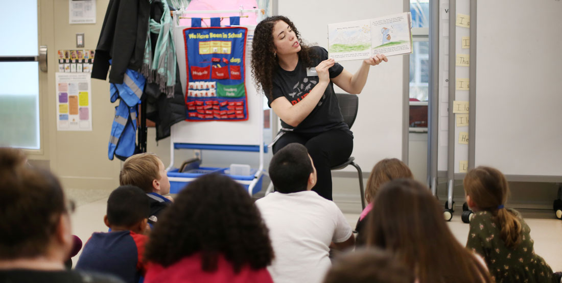 burke educator reads to students