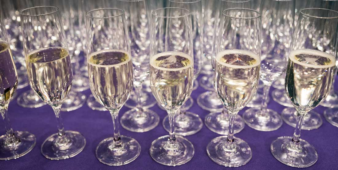 champagne  glasses on a purple tablecloth