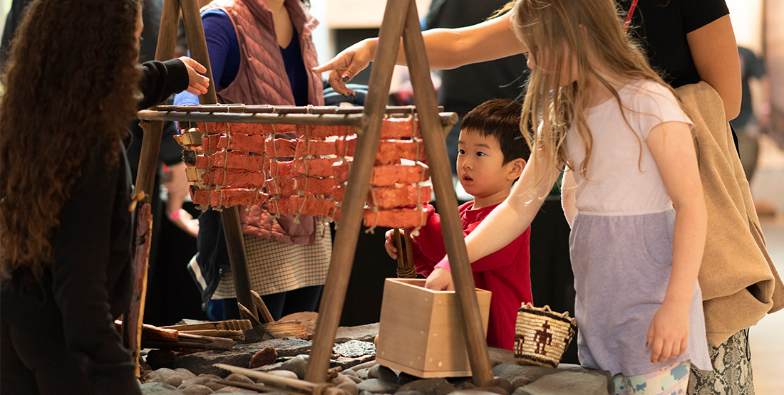 children play with an interactive in the archaeology gallery