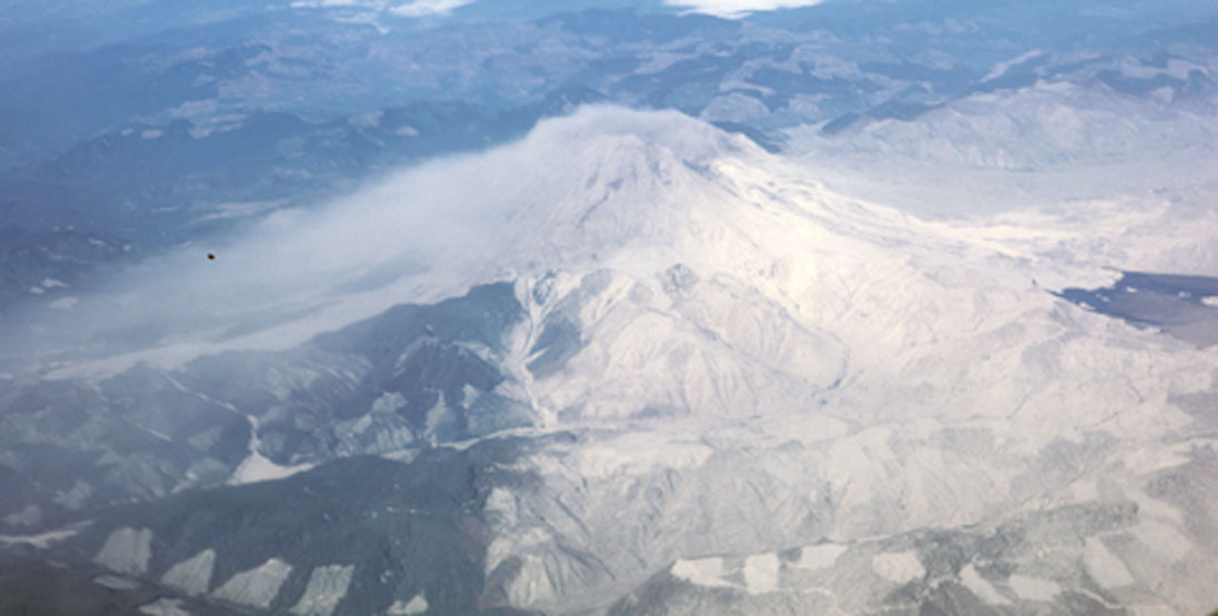 An aerial view of Mt St Helens post 1980 eruption shows where plants still grow and where the ash fell
