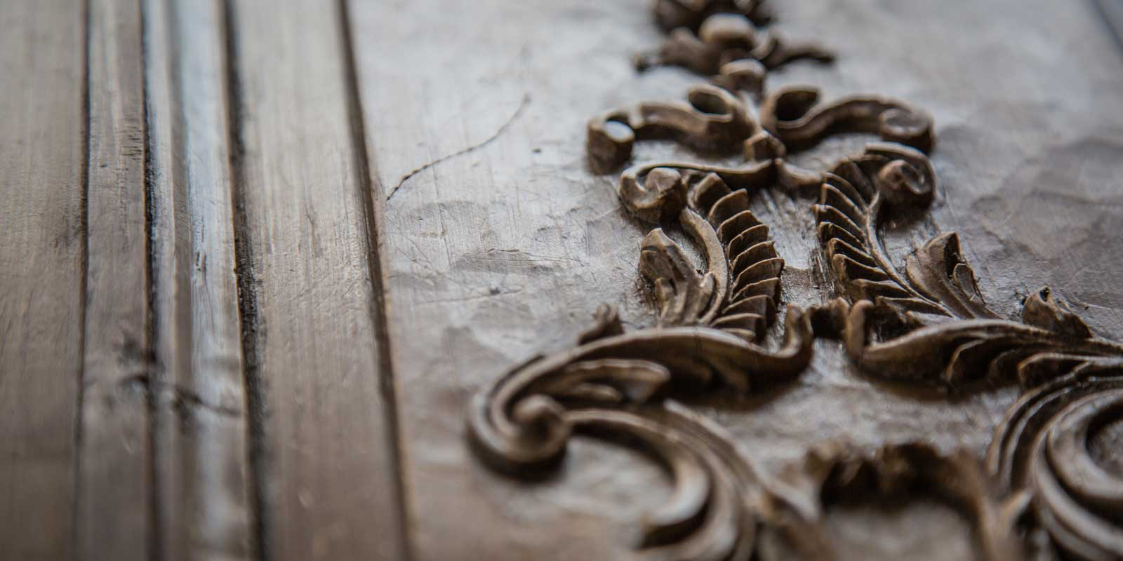 A close up of the intricate details in the wood showing toolmarks from the sculpter