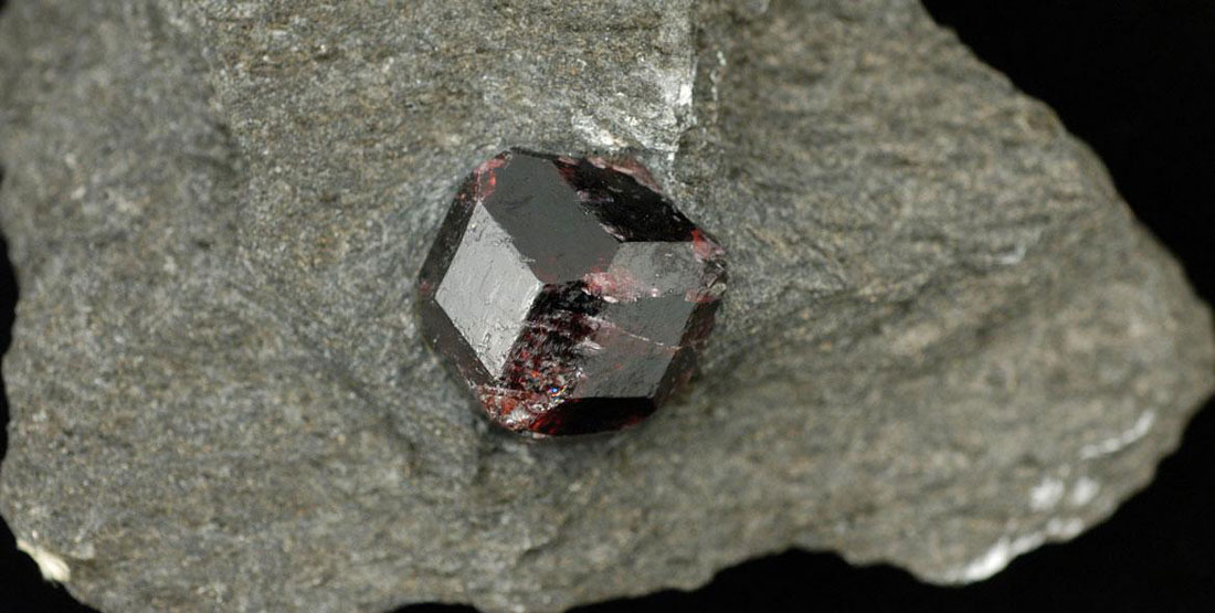 natural garnet polished gem on top