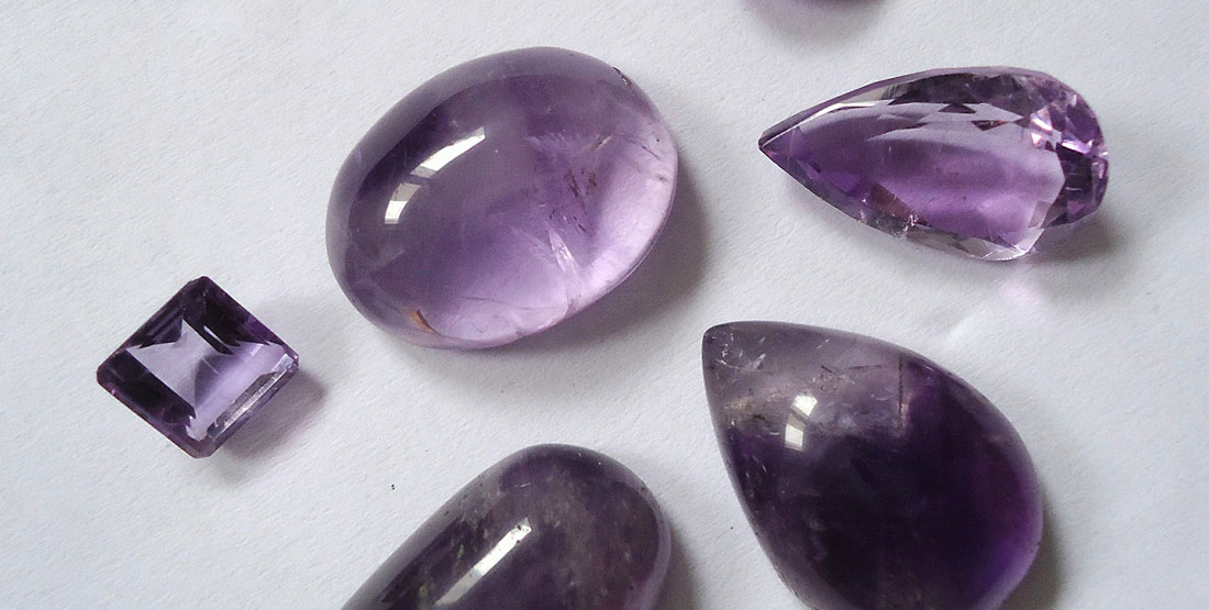 small pieces of cut and polished purple amethyst
