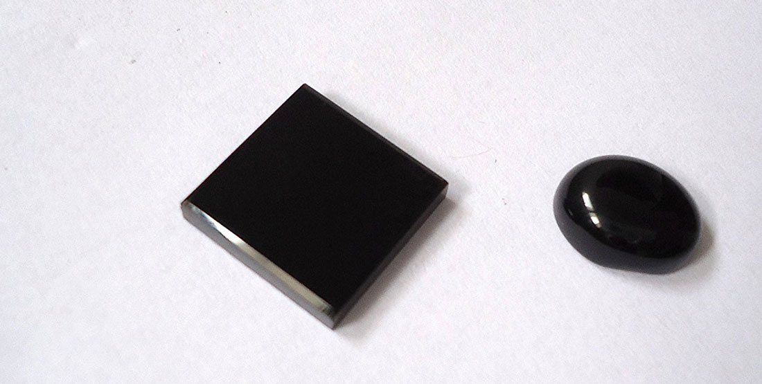 two pieces of polished black onyx