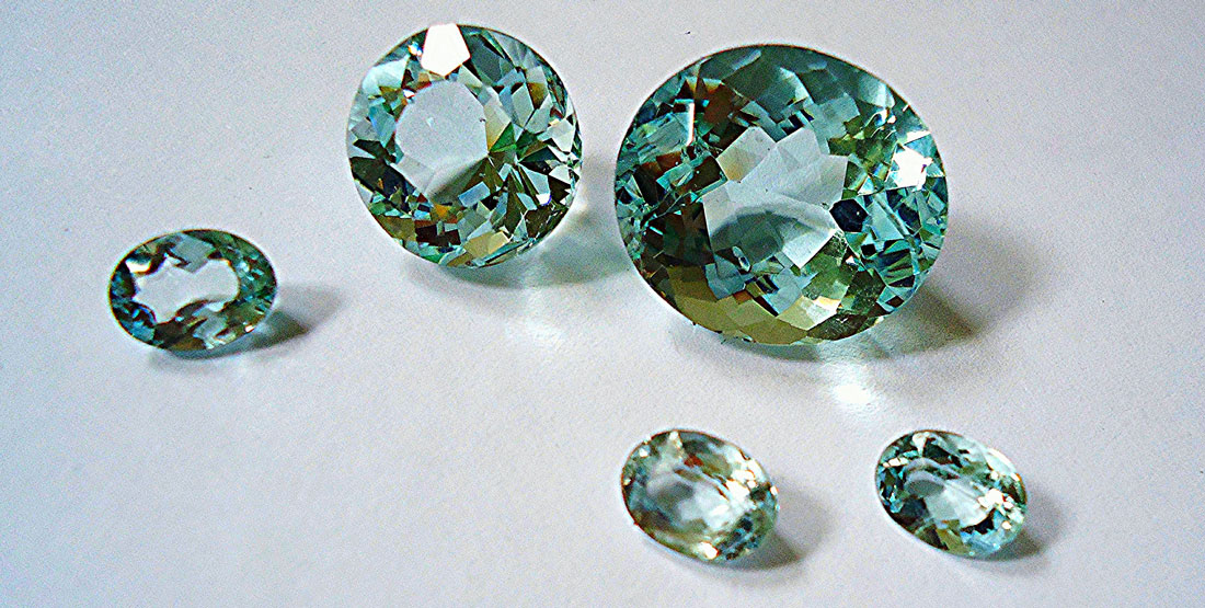 cut and polished aquamarine pieces