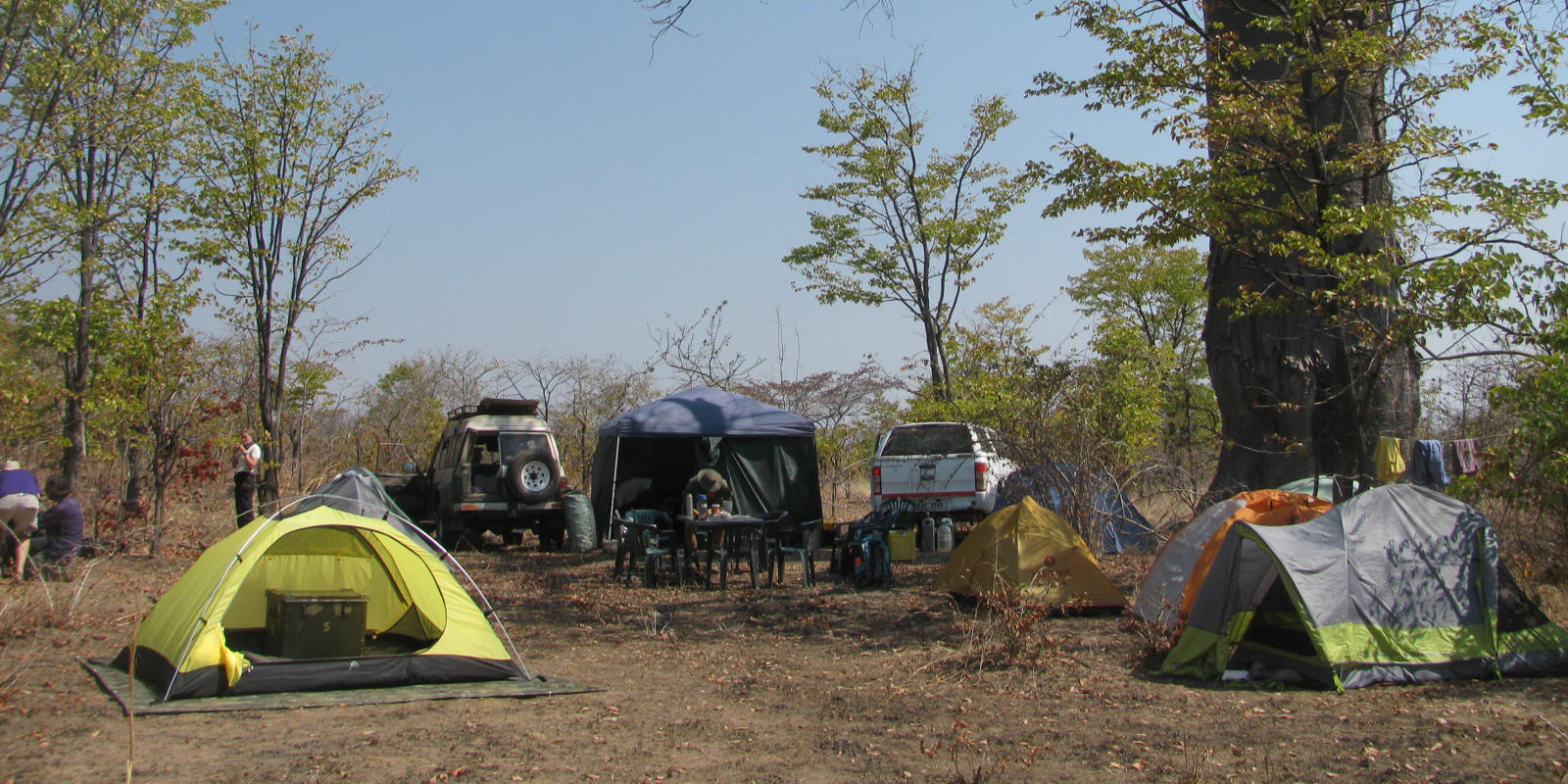 Tents and vehicles on flat terrain