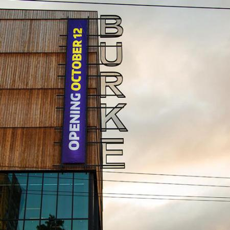 "new burke banner reading ""opening October 12"" on the side of the new building"