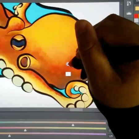 a hand colors an octopus digitally