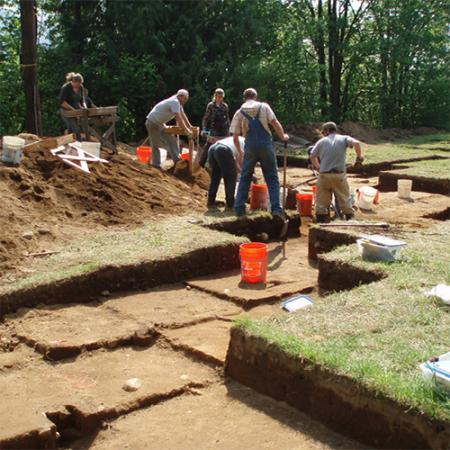 a team of archaeologists work at a dig site