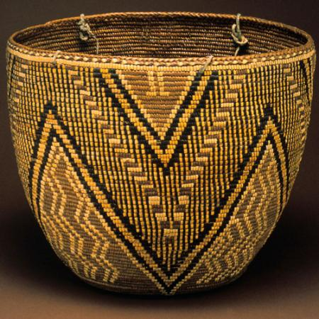 A completed woven basket with black diamond patters
