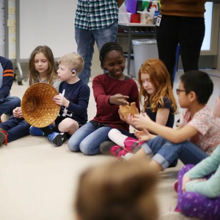 students interact with the Storytellers program